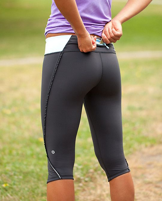 These pants are great for yoga or running.  The fabric looks sheer but it is tight to hold you in.  It doesn't show every little body flaw.  Love how the lines are slimming to the hips and the contrast color at the waist band is fun.  The back pocket is great for an ipod, key, cash, or a goo pack.