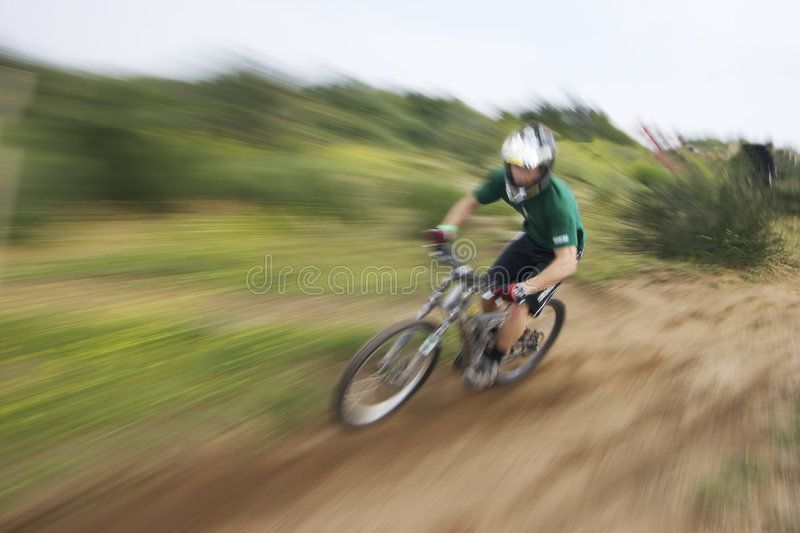 Zoom Blur Mountain Biker Photo Of A Mountain Bike Racer With A