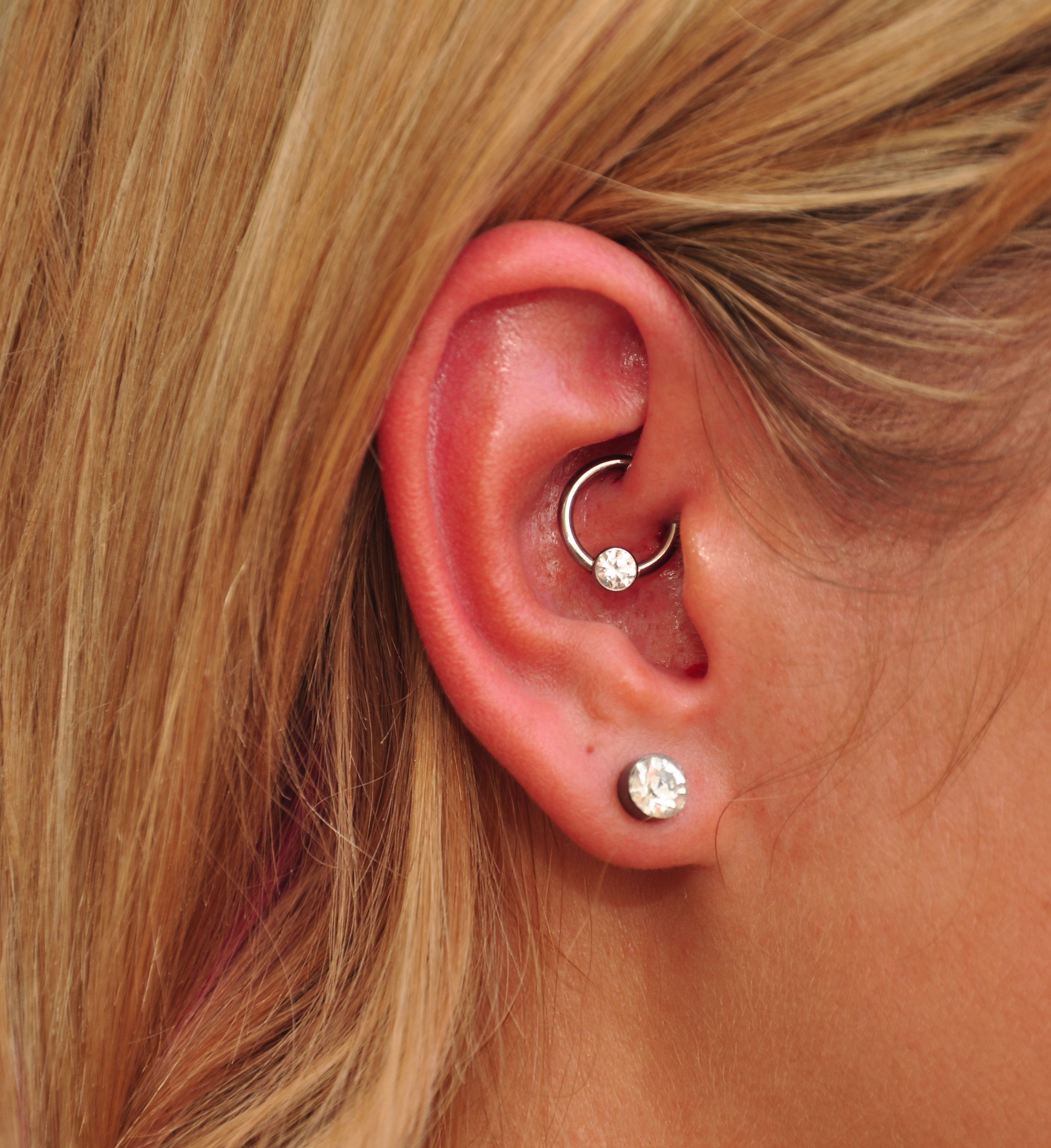 Piercing locations on body  fresh daith piercing with an Anatometal cbr and a bezel set CZ
