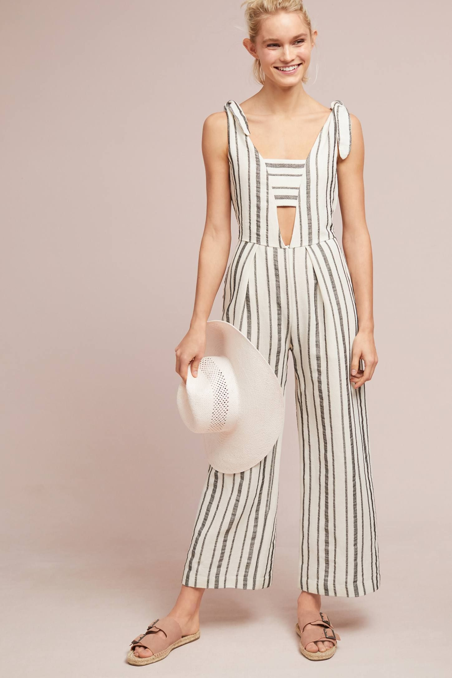 6a0e8f044c3 Shop the Levi s Beach Striped Jumpsuit and more Anthropologie at  Anthropologie today. Read customer reviews