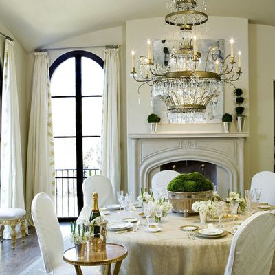 This dining room mimics Candice Olson's elegant transitional style with its use of neutral color, expensive lighting and chic finishes.