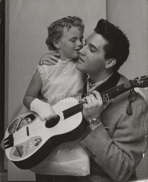 Elvis in Miami | March 24, 1960 Sheila Riddell, age 6 & Elvis | Photo Bob East/Miami Herald Staff