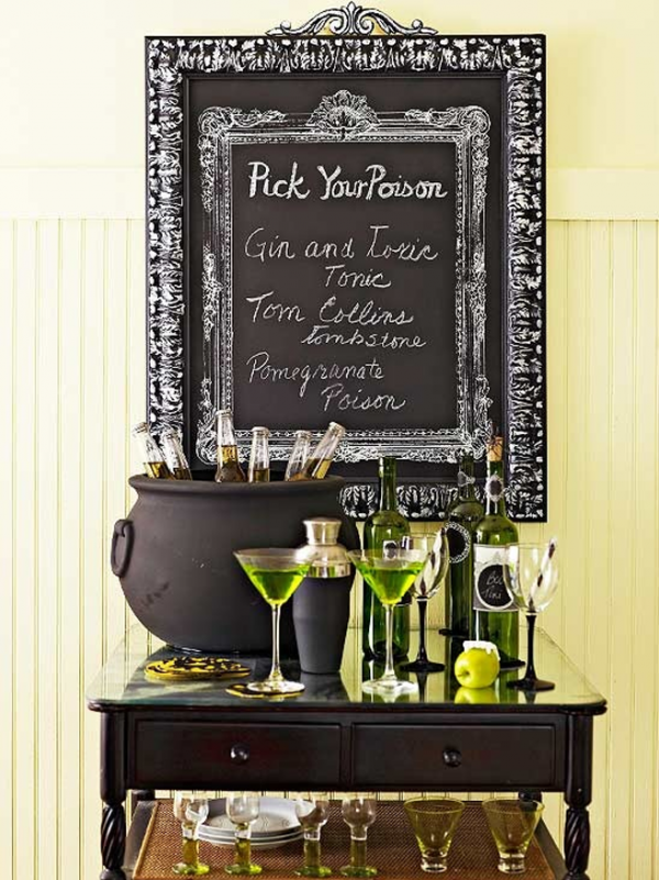 a drink station complete with beer filled cauldron and clever signage is a great way - Great Halloween Drinks