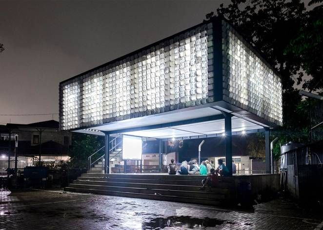 New micro-library's facade is clad with 2,000 recycled ice cream containers; sweet, sweet upcycling!