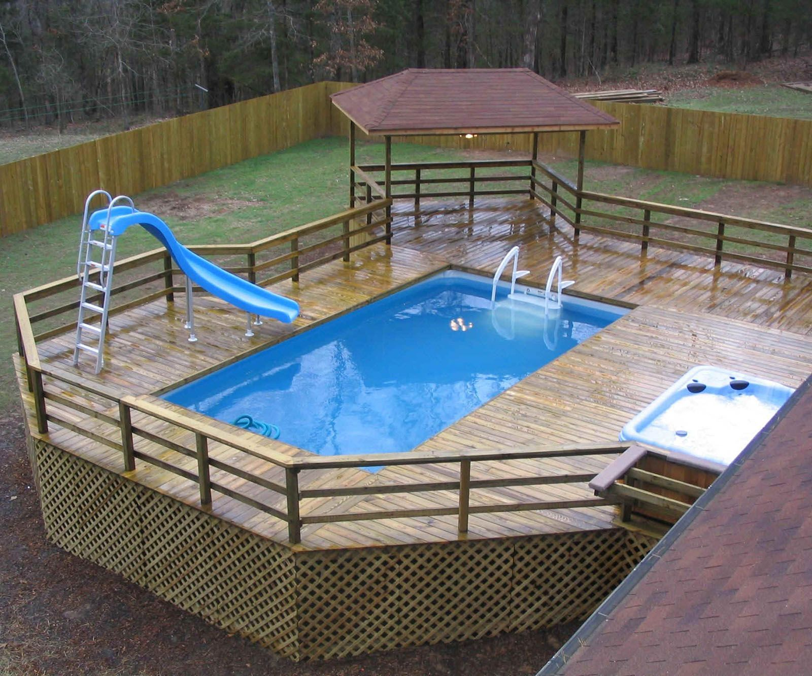 Swiming Pools Above Ground Pool Deck Design With Pool Spa Also Pool Slide And Wooden Fence Besides Pool Deck Plans Swimming Pool Decks Above Ground Pool Slide
