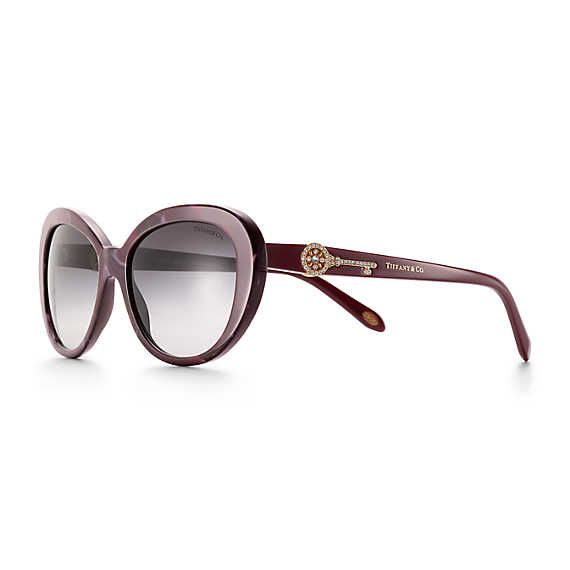 Tiffany Keys oval sunglasses in shell red acetate with rose gold-colored metal.