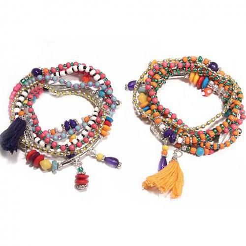 Multi pulsera elástica de #colores #metal #pompón . Tendencia #hippiechic