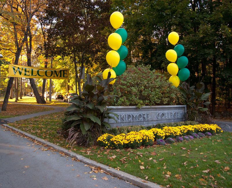 Welcome sign with balloons at Skidmore College in Saratoga Springs NY. In the fall, the trees turn beautiful colors when students return to campus.