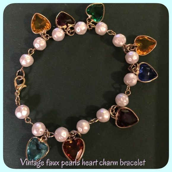 Vintage faux pearl & heart bracelet Vintage faux pearl with beautiful dangling colorful hearts, gold tone no hallmark beautiful piece Vintage Jewelry Bracelets