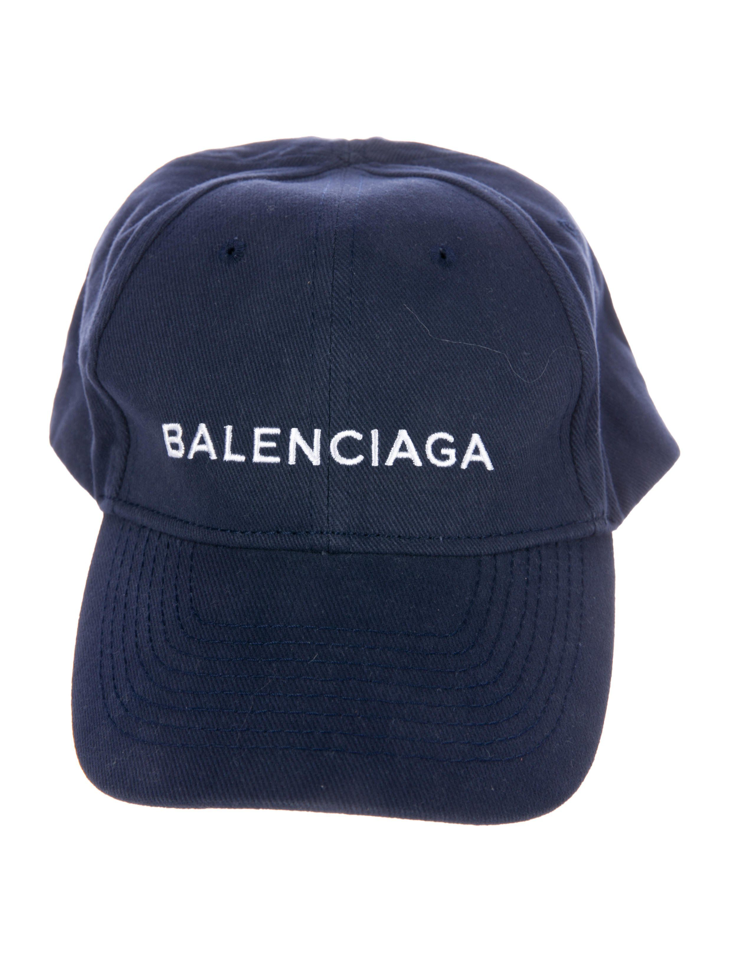 c9391daa98f Navy Balenciaga baseball cap with embroidered logo at front and gunmetal  adjustable snap closure at back. Designer size L. Includes dust bag.