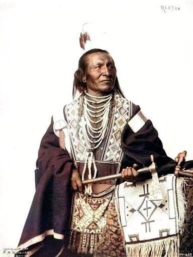 RED FOX (Tokala Luta). Oglala Lakota, 1899. Photo by F.A. Rinehart.
