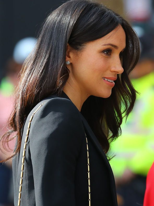 Meghan Markle wears DARING low cut £385 dress next to Prince Harry on Queen's birthday