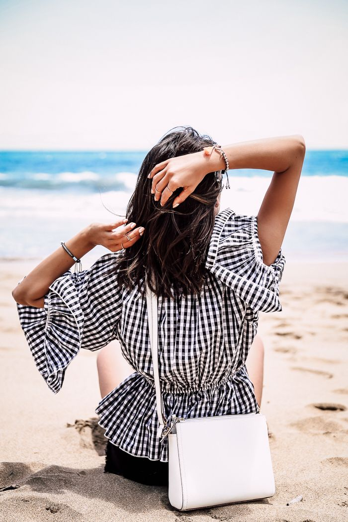 black and white casual summer outfit - off the shoulder gingham top + cross body white bag
