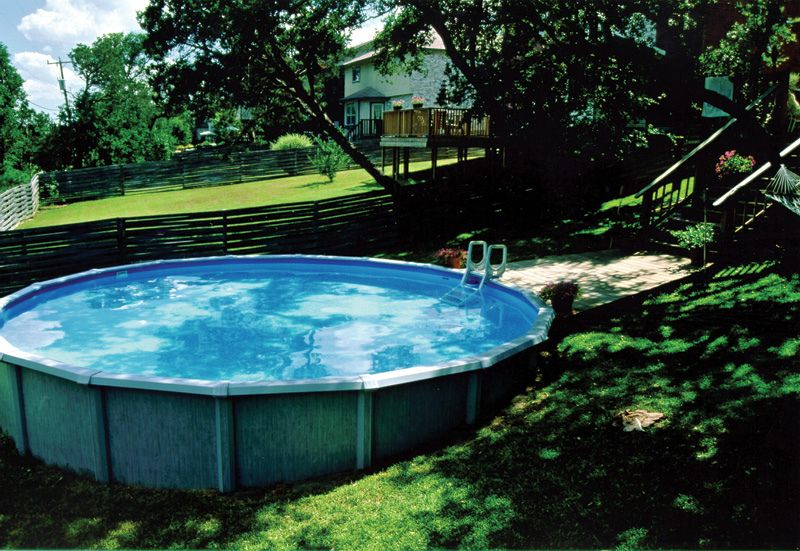 Above Ground Pool In Sloped Backyard Above Ground Swimming Pools Backyard Pool Landscaping Sloped Backyard