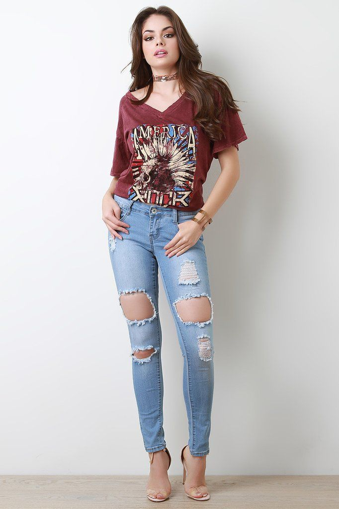 These Jeans Features A Light Wash Design Distress Holes Cutout