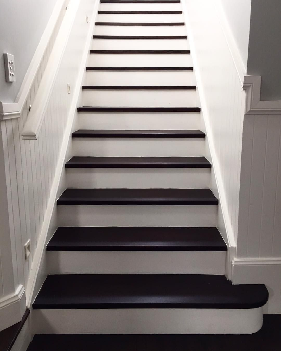 A Beautiful Effect Achieved By Staining The Treads And Painting The Risers.  #stairs #stairway #entry #wainscotting #hallway #interior #design
