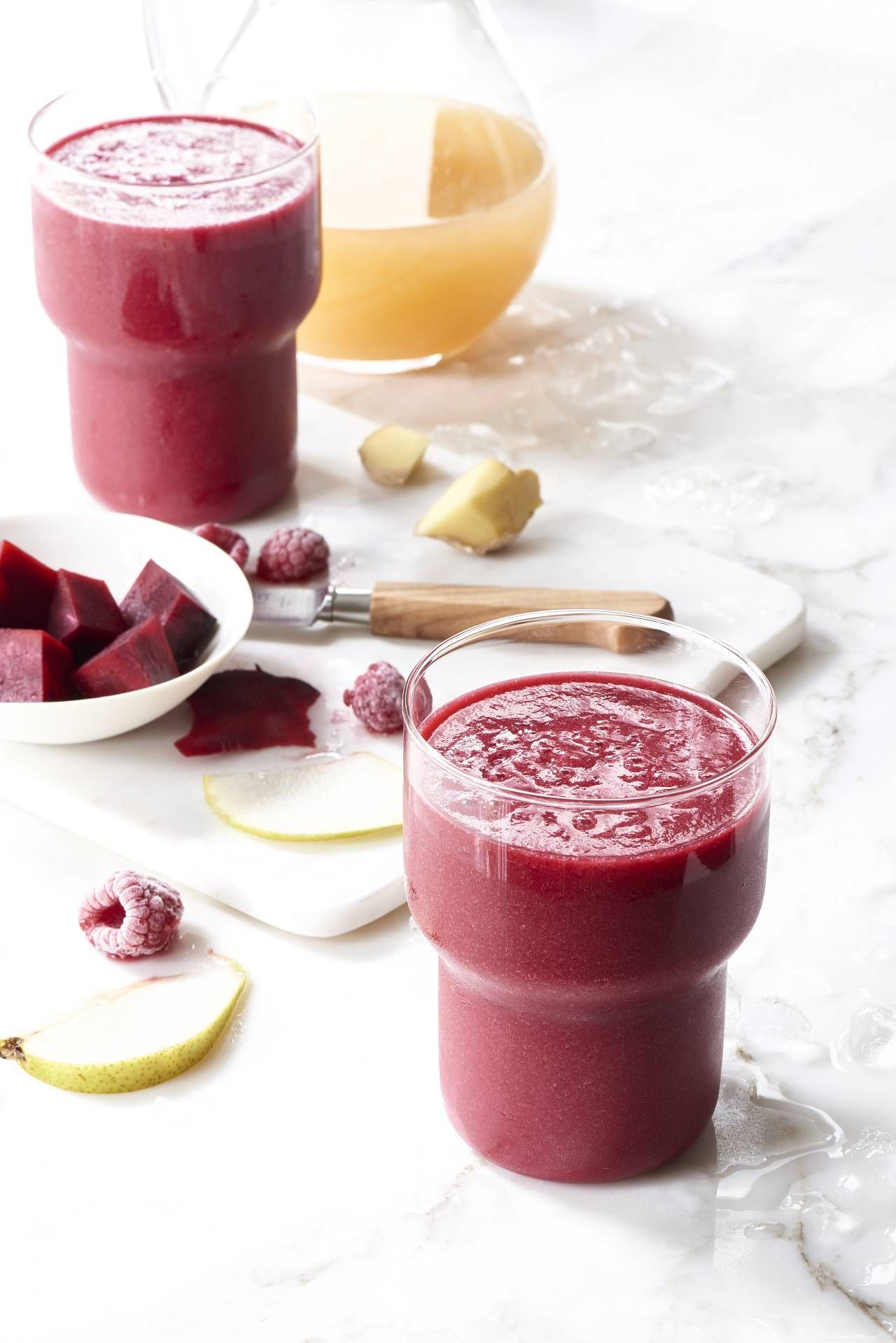 This Vegan Beet Berry Smoothie made with the @kitchenaidusa Pro Line® Series blender is easy, healthy, and delicious. A mix of unfiltered apple juice, pear, raspberries, and ginger to create a blend that is sweet and refreshing, and has a gorgeous pink color.