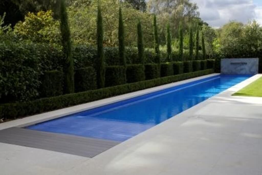 High Quality Pool Design, Clean Lap Pool Design Ideas With Trimmed Bush Beside And  Marble Paving: