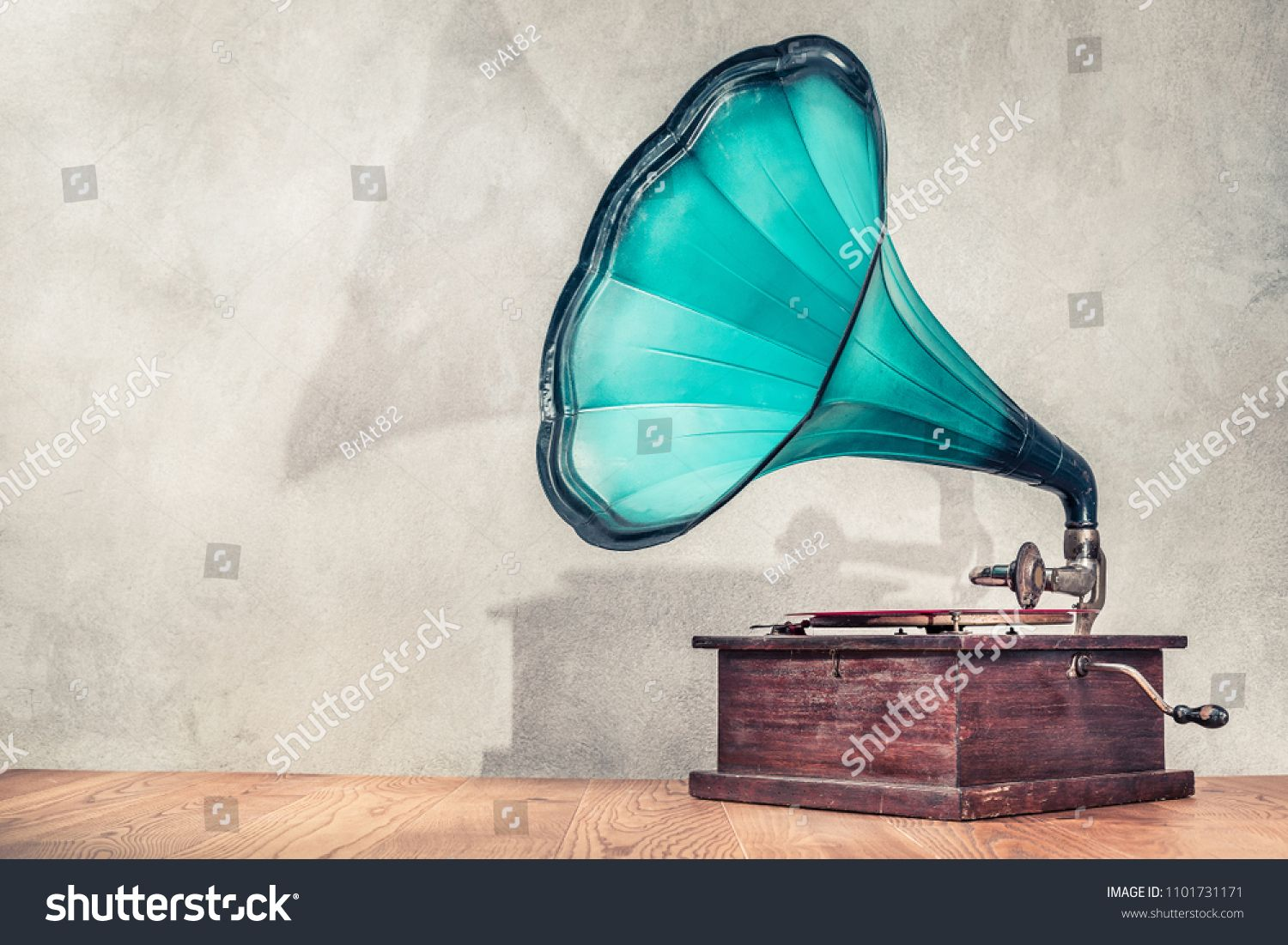 Vintage antique aged aquamarine gramophone phonograph turntable on wooden table front concrete wall background with its shadow. Retro old style filtered photo #Sponsored , #Affiliate, #turntable#phonograph#table#wooden