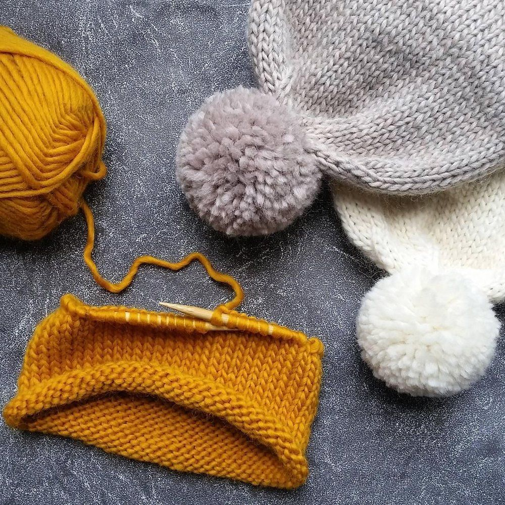 Double Brim Mustard Knit Pom Pom Hat Knitting pattern perfect for winter!  Find this pattern and more knitting inspiration at LoveKnitting.Com. edd87616553