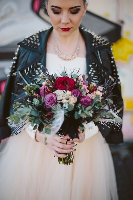 4a154f13a grunge bride in an ivory dress, a spiked leather jacket with bold makeup