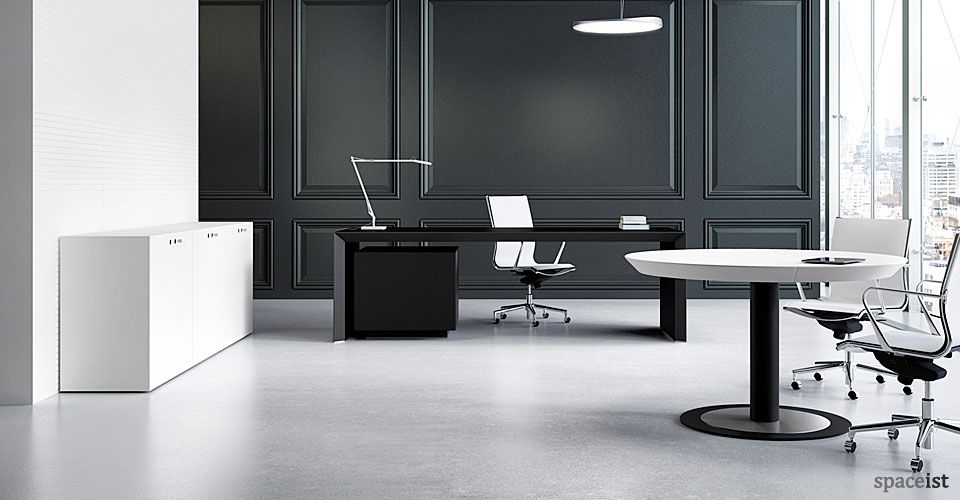 Black minimalist executive desk in oak or walnut veneer. Desk sizes include 180, 220 and 240 cm. Matching meeting room table and storage cabinets.