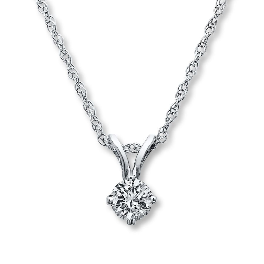 An irresistible carat round diamond is the alluring focal point