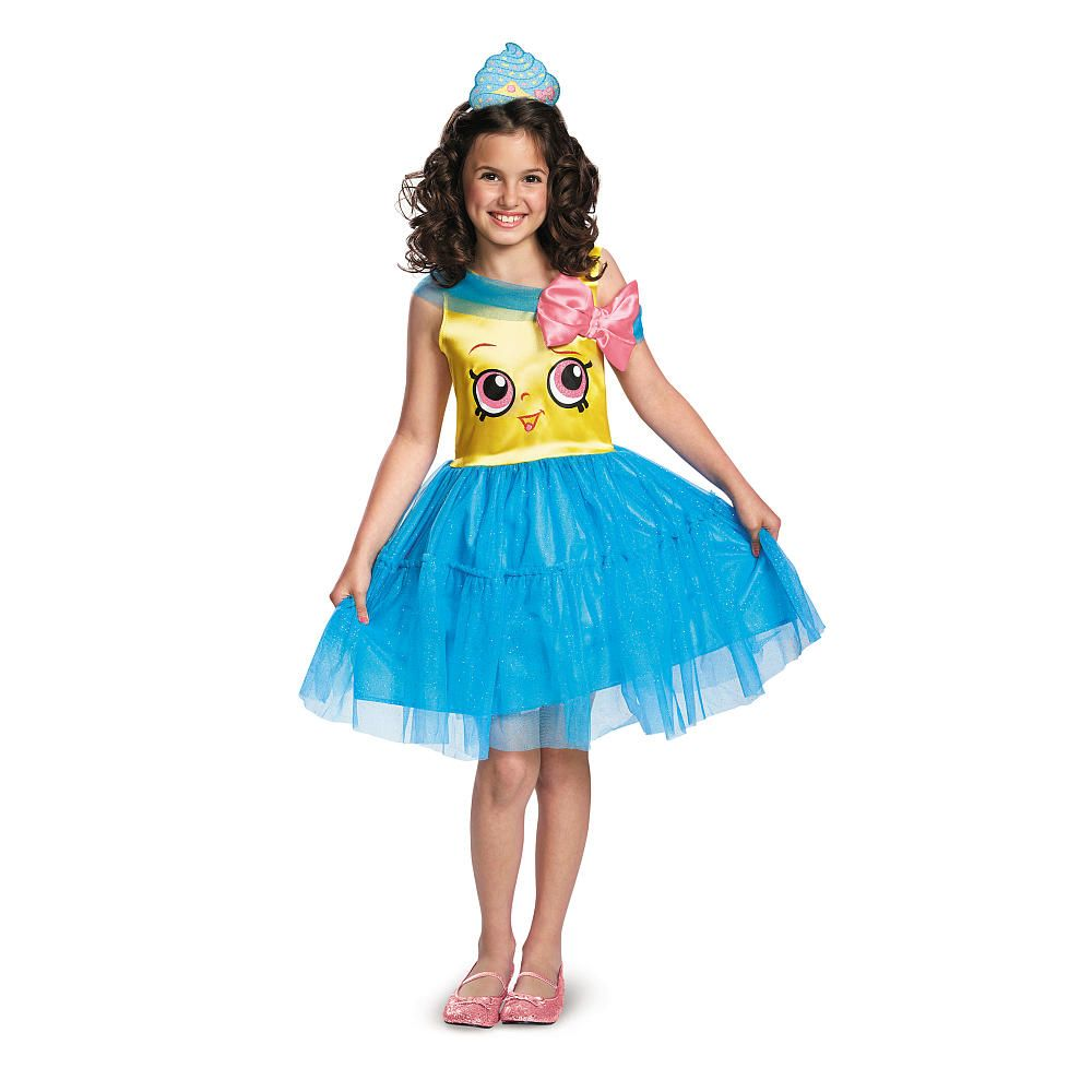 """You'll have the sweetest costume in the snack shop! This charming Shopkins Cupcake Queen Classic costume features glitter-print Cupcake Queen art on the bodice, skirt with acrylic jewel 'sprinkles' detailing, a stylish over sized bow at the neckline and even a character-accurate frosting headpiece! Product includes: Dress and headband.<br><br>Our online <a href=""""http://www.toysrus.com/category/index.jsp?categoryId=2465428""""><b>Halloween Shop</b></a> is the destination for an expanded…"""
