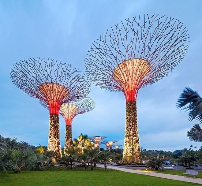 bespoke concrete pebble seats dwarfed by supertrees at gardens by the bay singapore - Garden By The Bay Event