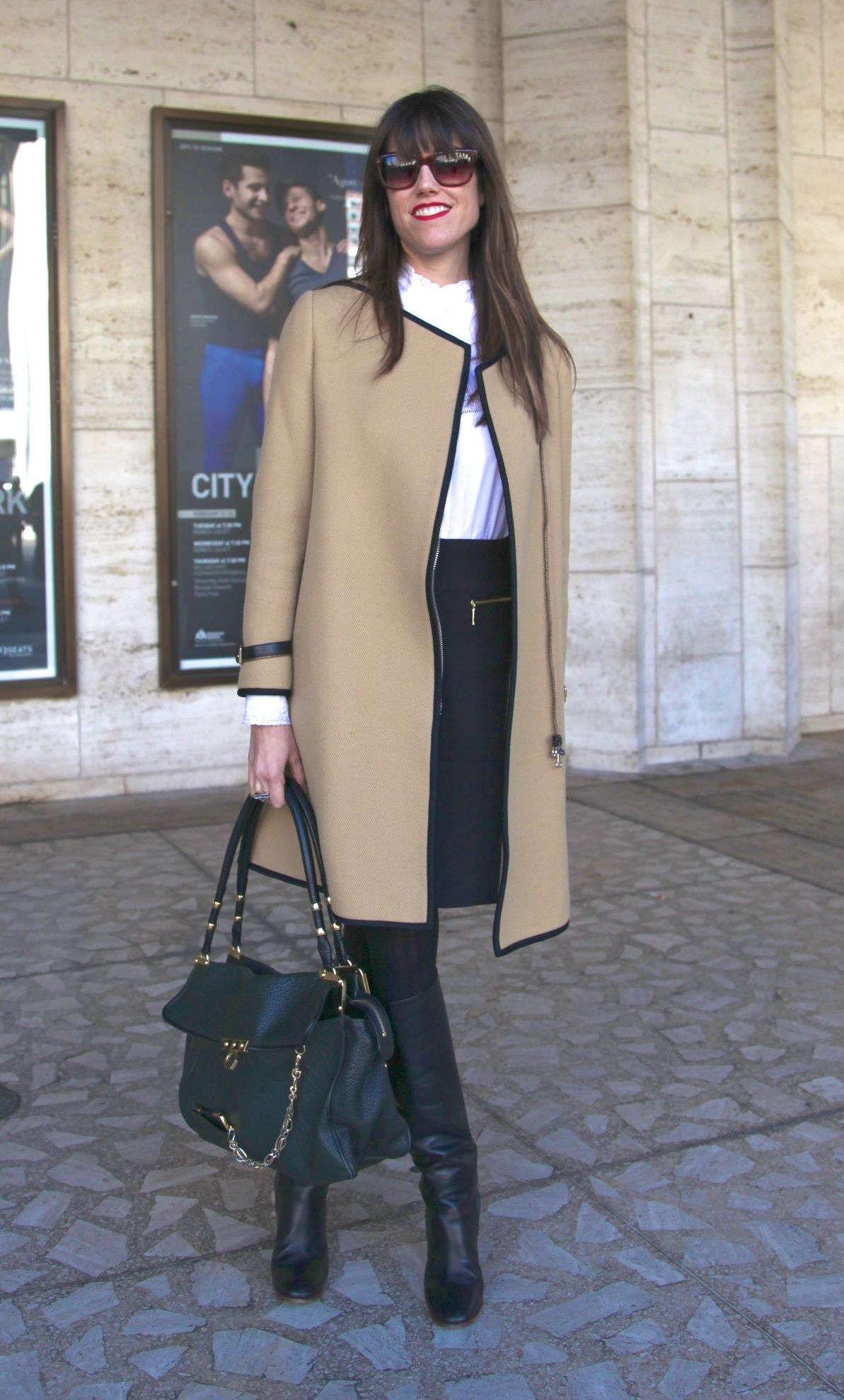 Her Camel Coloured Jacket Paired With A Crisp White Shirt And Black Skirt Is Clic Modern Nod To Men S Wear