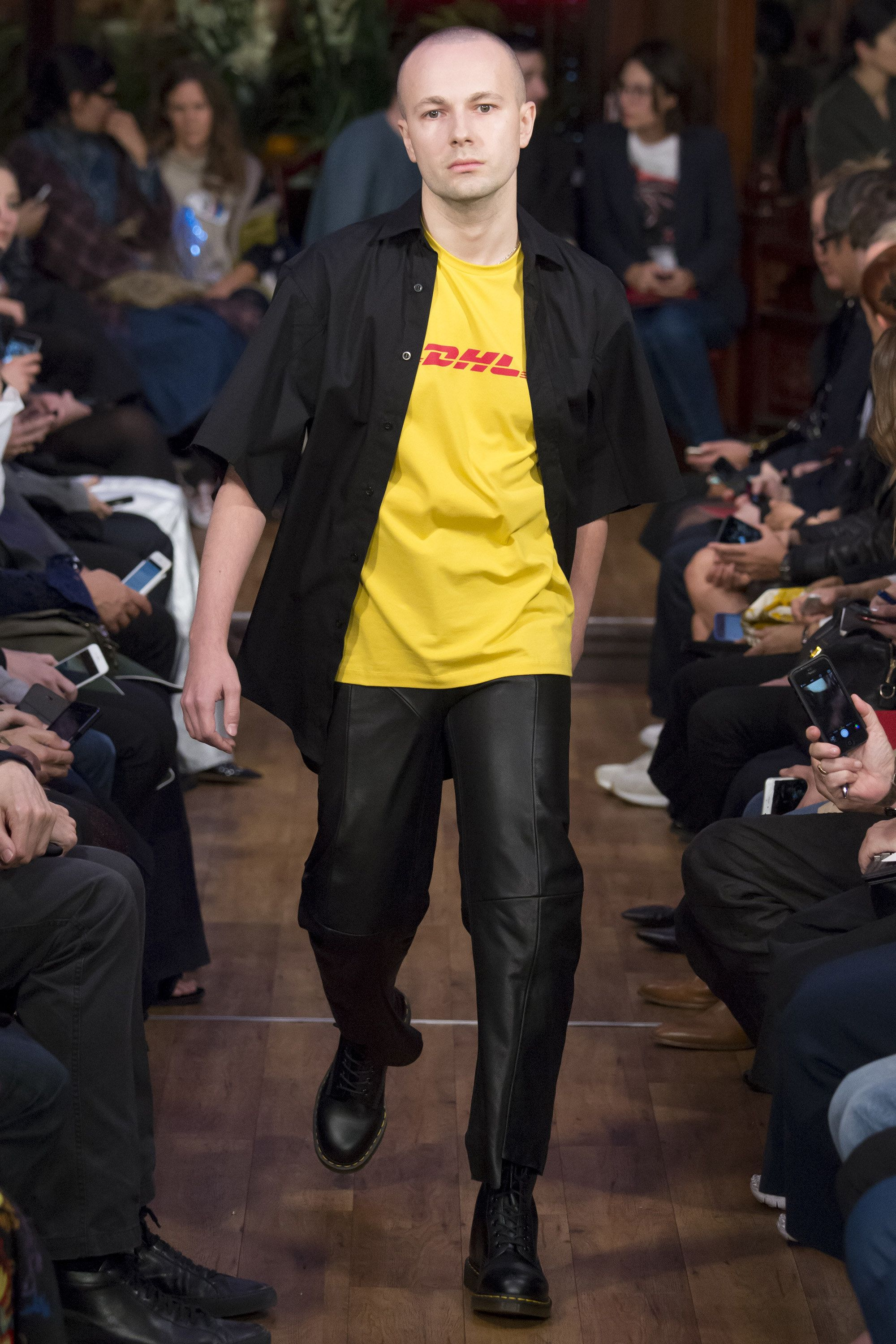 dc776e2c33ed16 The Russian designer and streetwear sensation Gosha Rubchinskiy opened the  Vetements SS16 show in Paris. Wearing a yellow DHL T-shirt and a scrappy  leather ...