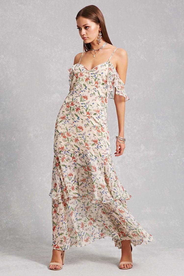 A chiffon maxi dress featuring an allover floral print an open