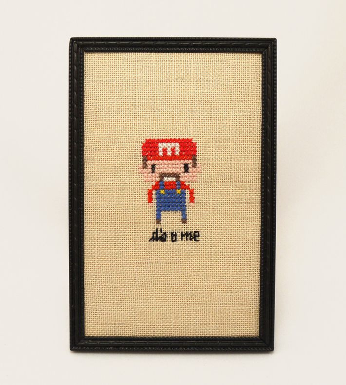 'It's a me'  Geeky fan art gone retro ♥  This tiny pixelated hero in a frame is handmade by me. It's 9.5 x 14.5 cm and ready to stand or hang.  The completed cross stitch comes in a painted black vintage frame.  Sweet Stitches brings together cross stitching and retro frames with lots of popular heroes from the wonderful worlds of TV, movies, cartoons, music and art.  Every purchase is gift wrapped with care, ready for gift giving or a geeky treat for yourself.  If you're ...