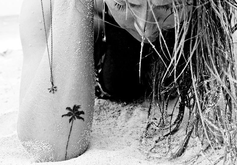 Cute small palm tattoo