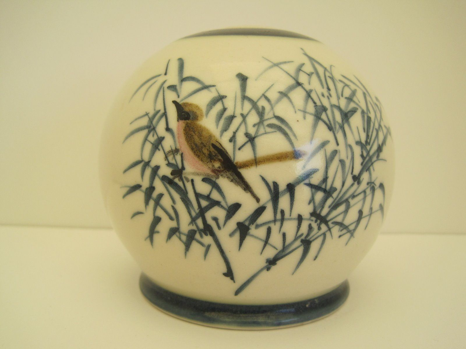 http://www.ebay.com/itm/Vintage-signed-ceramic-vase-candle-holder-with-bird-and-bamboo-design-/111753590040?