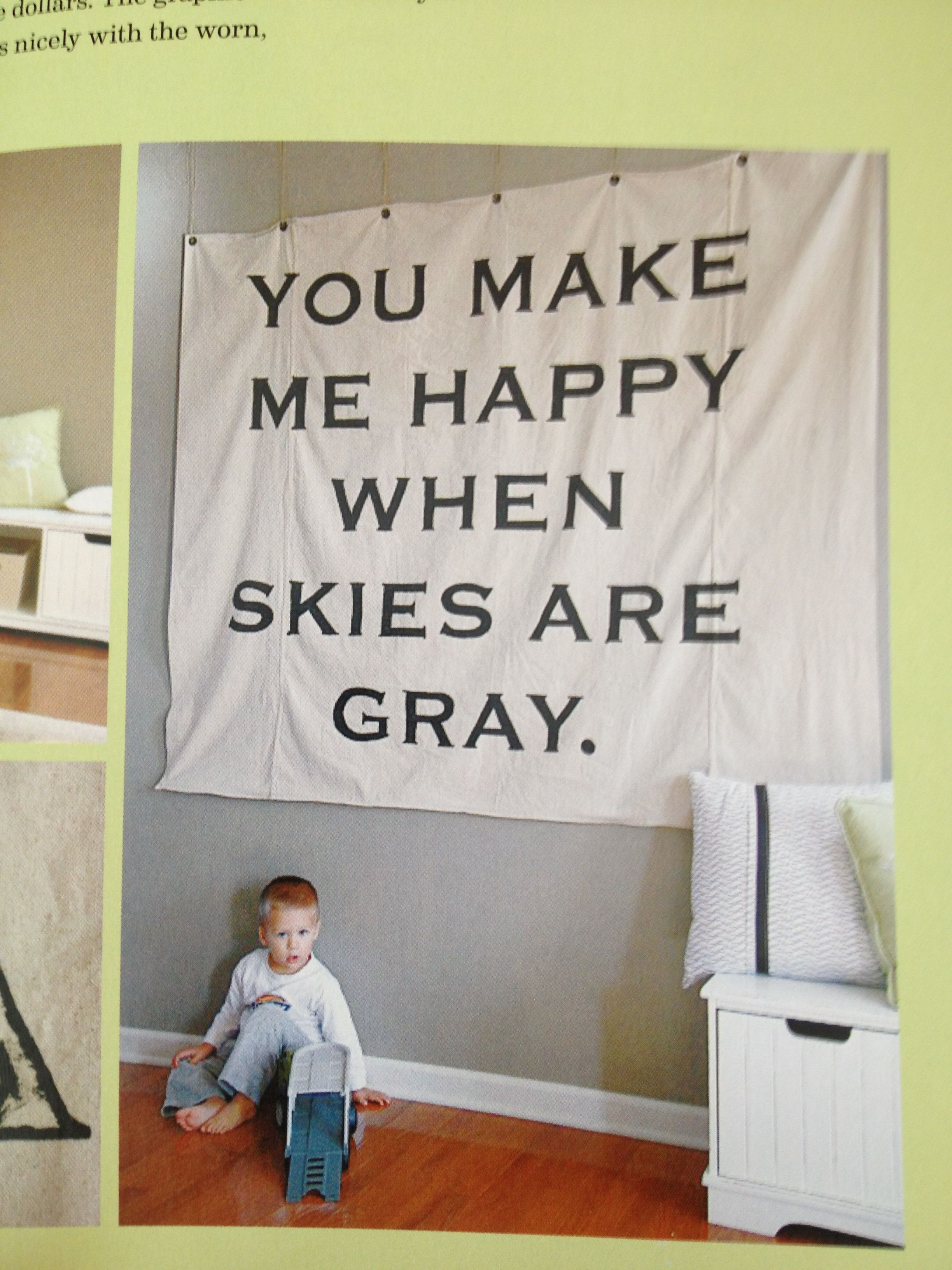 Stencil a quote or phrase onto a drop cloth for inexpensive wall art. From the book, Young House Love.