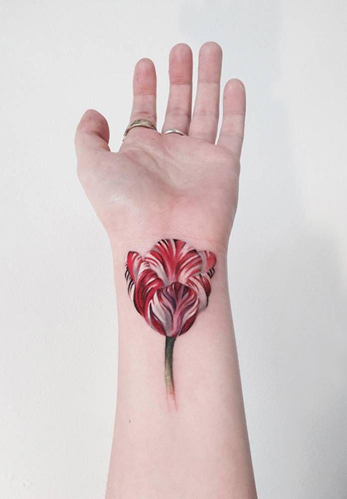 Tulip tattoo on the left inner wrist.