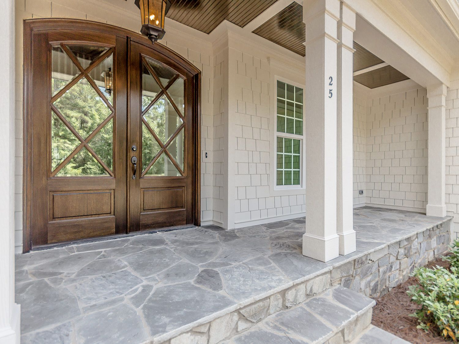 Flagstone Porch And Beautiful Doors By