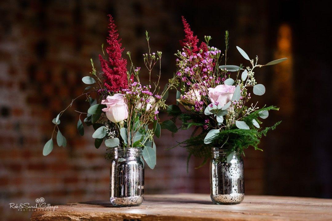 Mercury Vase Of Marsala And Blush Flowers Jars Of Flowers Registrar Flowers Deep Red Asti Flowers In Jars Wedding Centerpieces Wedding Table Centerpieces