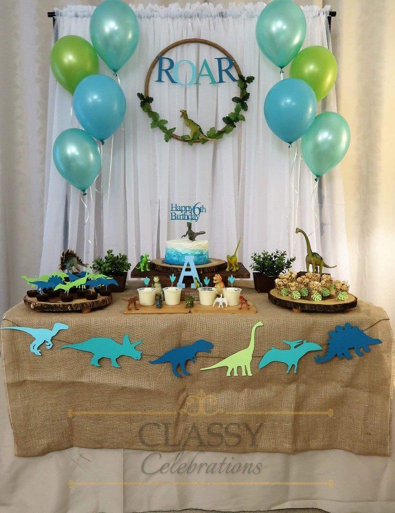 Pin By Classy Celebrations On Dinosaur Theme Birthday Table Decorations Dinosaur Theme Decor