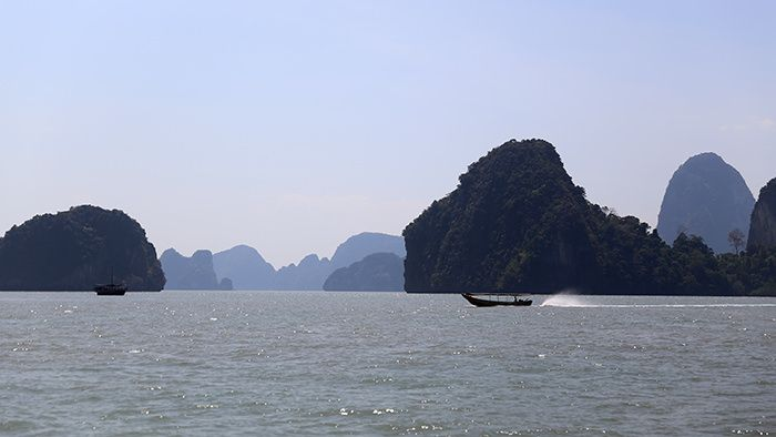 "If you find yourself in Phuket, it would be a shame not to experience the fascinating Phang Nga Bay. Infamous since the release of films such as Roger Moore's ""The Man with the Golden Gun"" and Leonardo Di Caprio's ""The Beach,"" the bay is known for its unusual limestone rock formations, emerald waters, and ideal year-round swimming conditions. Phang Nga Bay is located between Phuket and the Malay peninsula of southern Thailand."