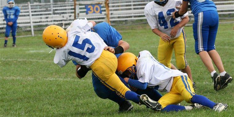 Kids playing football kids playing football concussions