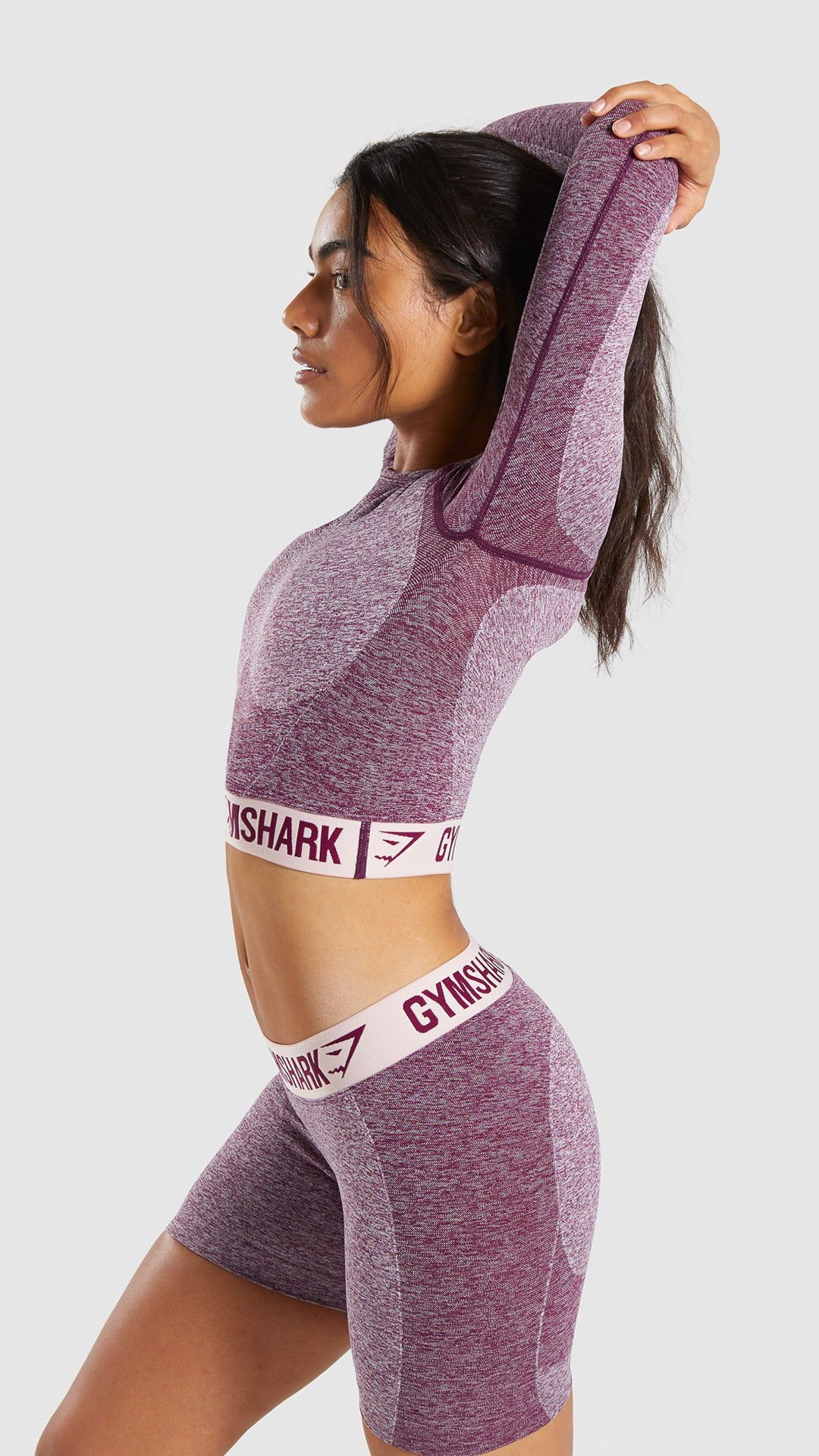 7118819d99ffd The Gymshark Flex Long Sleeve Crop Top, Dark Ruby Marl/ Blush Nude.  Combining our signature seamless knit with superior, sculpting design.