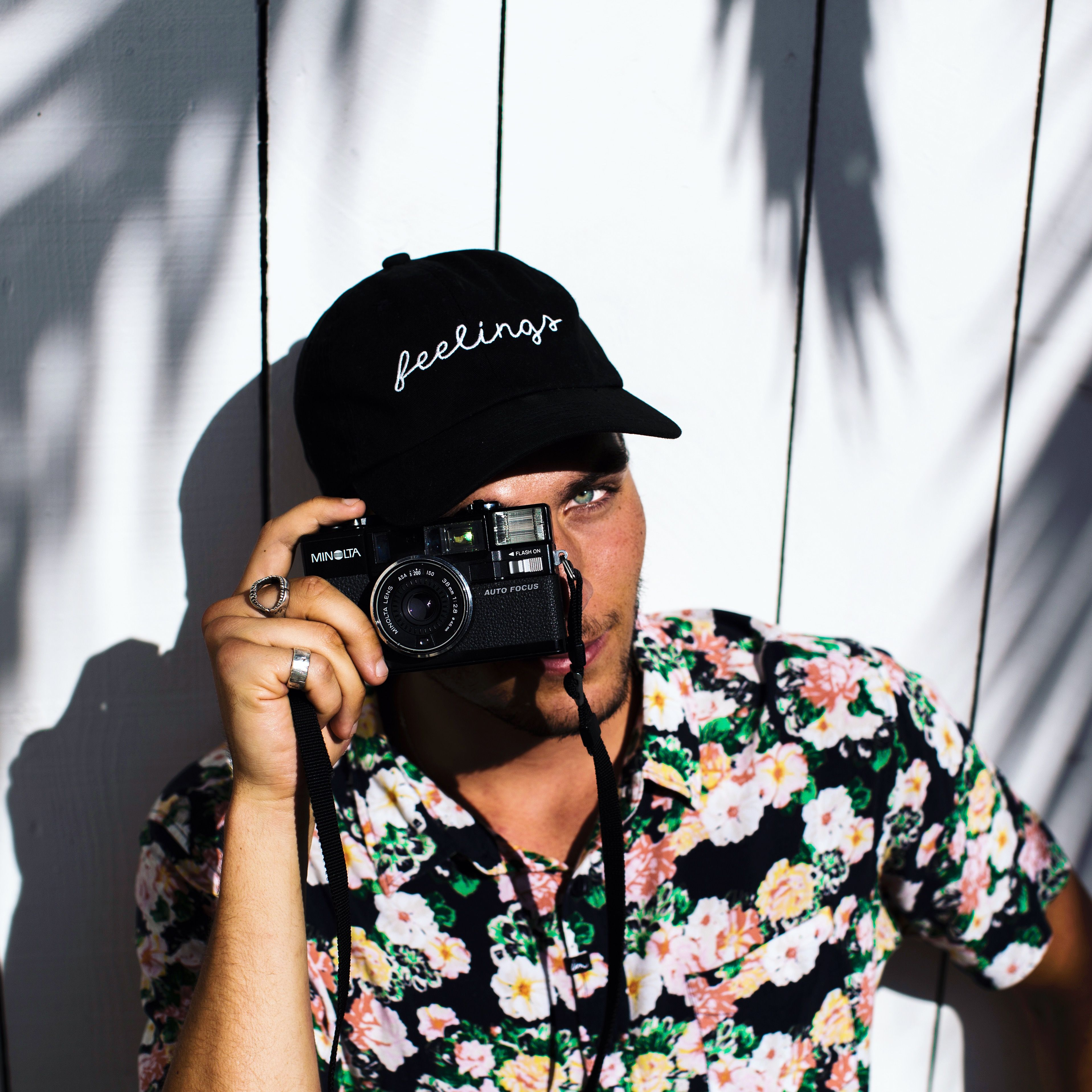 @captainbarto taking a photo of someone taking a photo of him. Wearing a Feelings By Alex hat and an Imperial Motion button down shirt in Los Angeles, California.  www.captainbarto.com