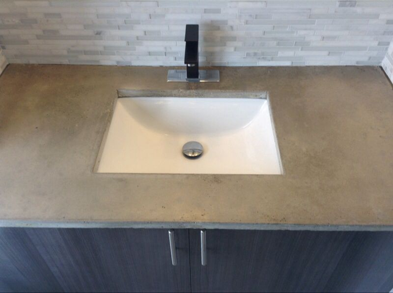 DIY concrete bathroom vanity with marble tile. create wood mould mix  concrete with water pour and set attach sink with caulking and let dry