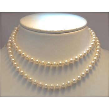 """33"""" strand of cultured pearls.  Magnificent luster and coloration.  6.50-6.77mm pearls and a 14K yellow gold clasp."""