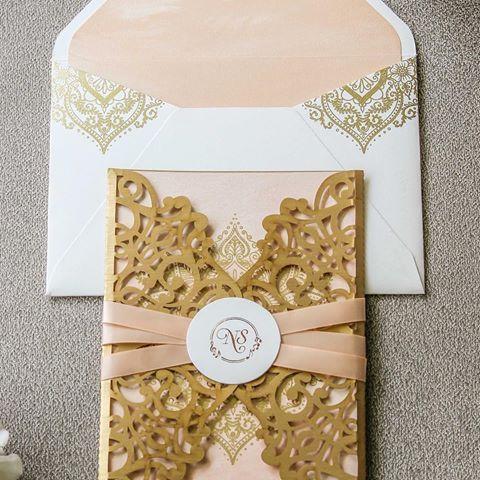 The laser cut gold jharokha patterns on this pastel invitation card - invitation card kolkata