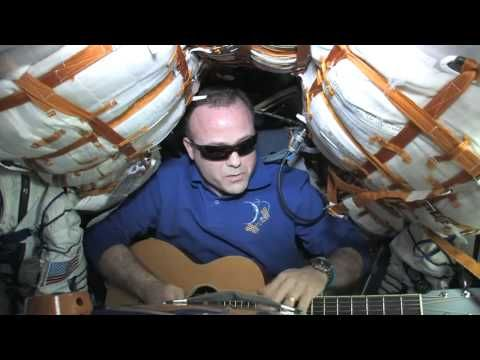 NASA astronaut Ron Garan sings the blues from the Soyuz spacecraft docked to the ISS.