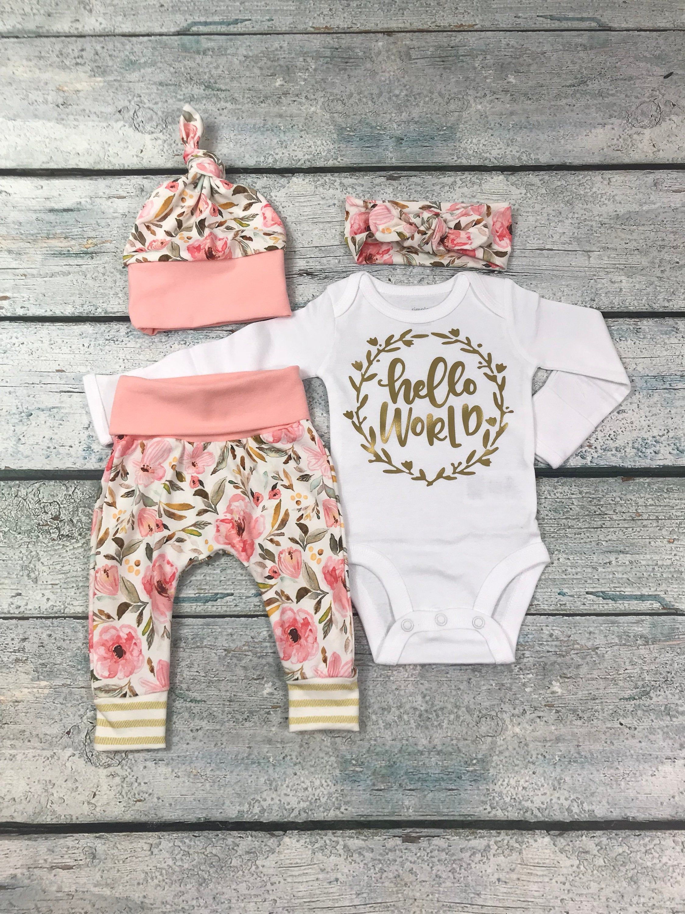 Photo of newborn girl coming home outfit/ hello world floral set/ baby girl newborn set