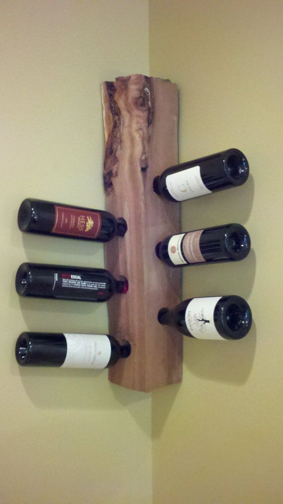 Unusual Wall Mounted Corner Wine Rack Storage With Sanded Tree Trunk Material And Rectangular Block Shape